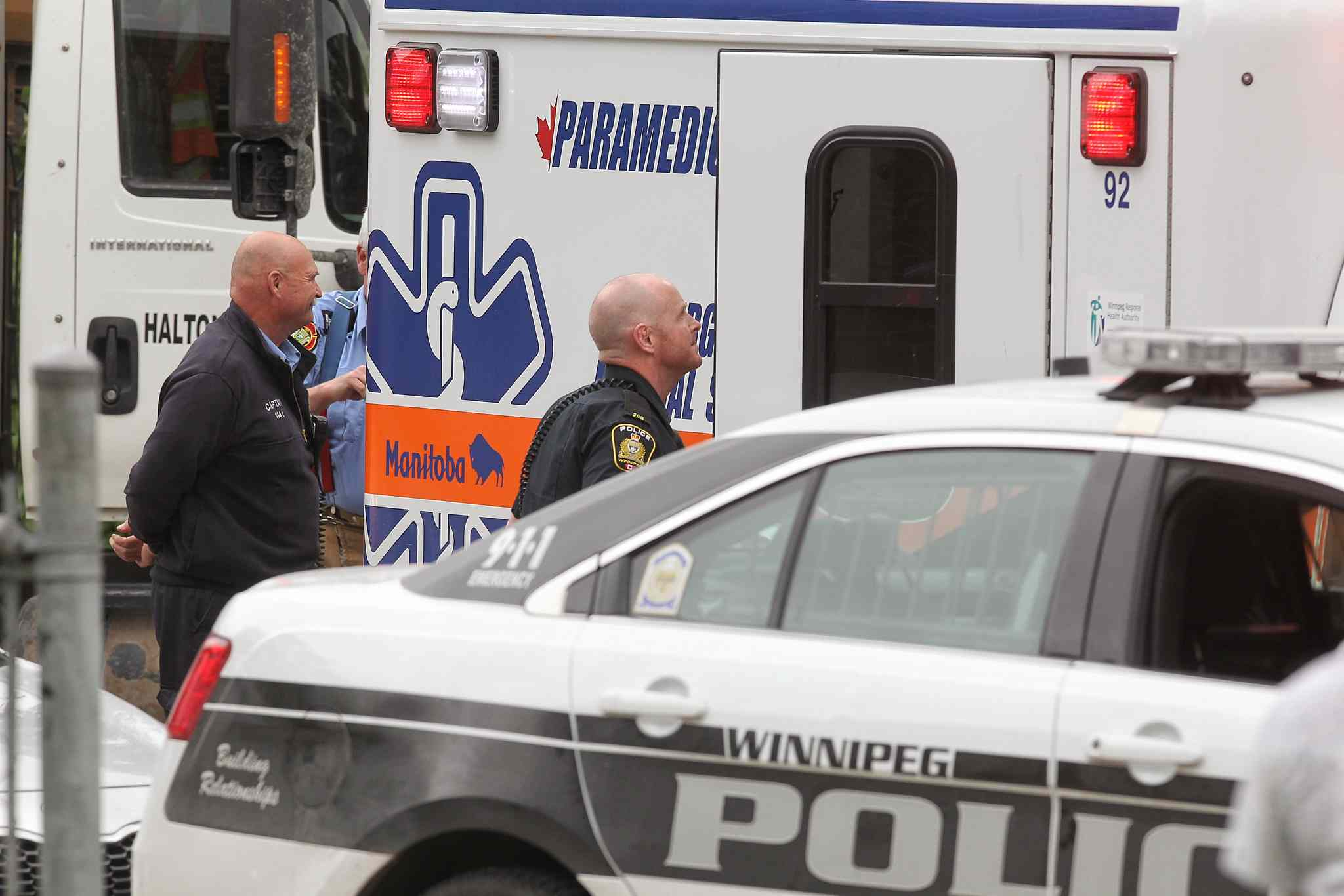 An ambulance gets ready to leave Kelvin High School early Tuesday afternoon.