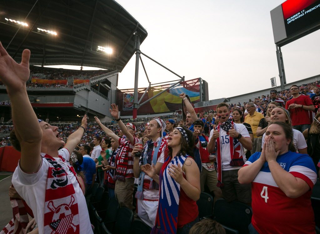 A group of USA fans known as the American Outlaws cheer on Team USA against Australia at Investors Group Field, now known as Winnipeg Stadium, for the FIFA Women's World Cup.  (Melissa Tait / WINNIPEG FREE PRESS)