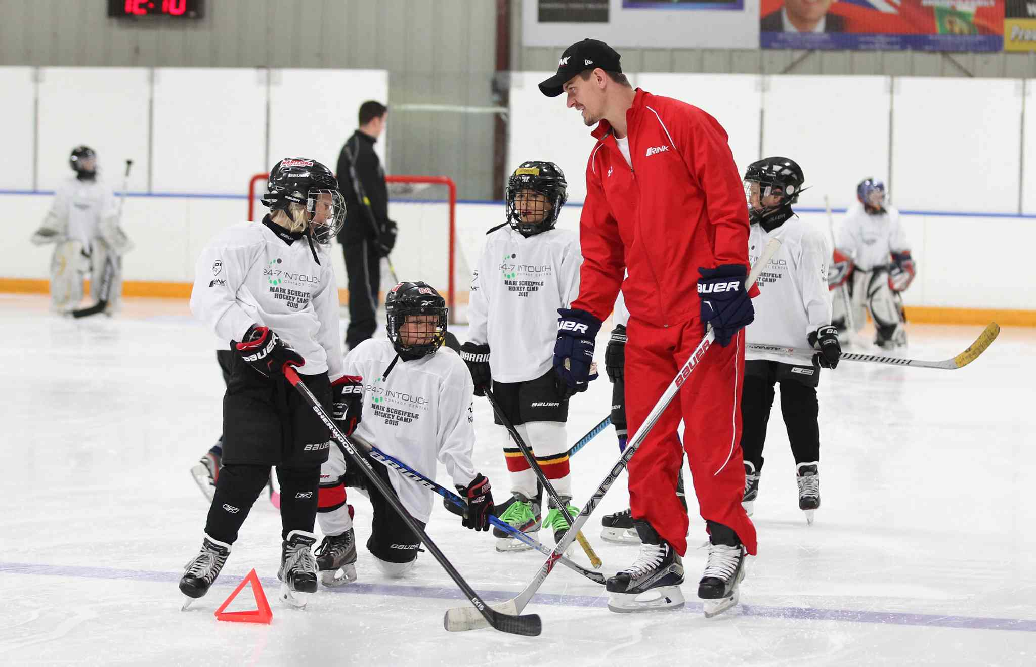 Winnipeg Jets hockey star player Mark Scheifele works with young hockey players on the ice in a hockey camp at Gateway Recreation Centre Saturday in support of KidSport Winnipeg.
