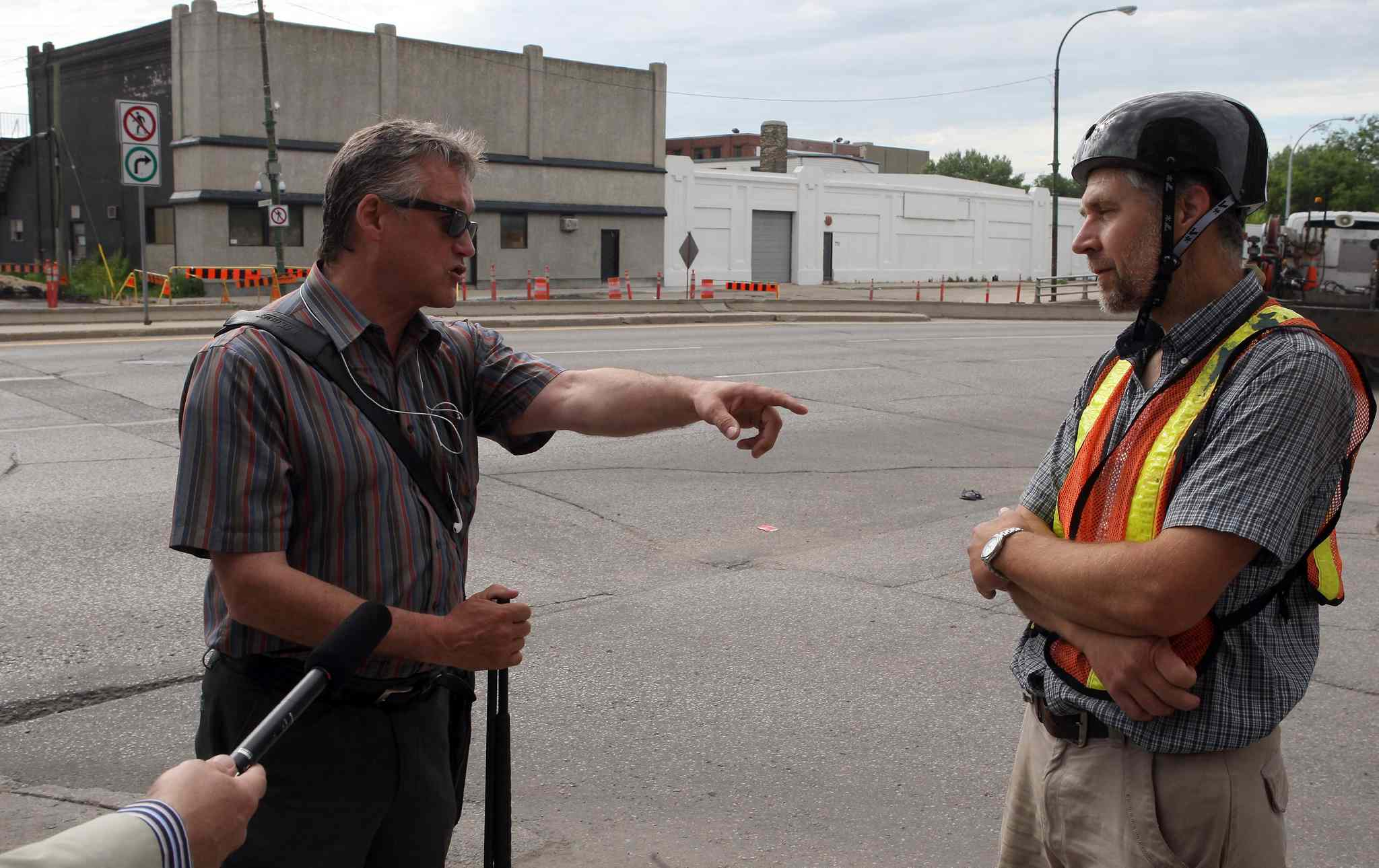 Ross Eadie (left) and cycling activist John Wilmot square off Monday.