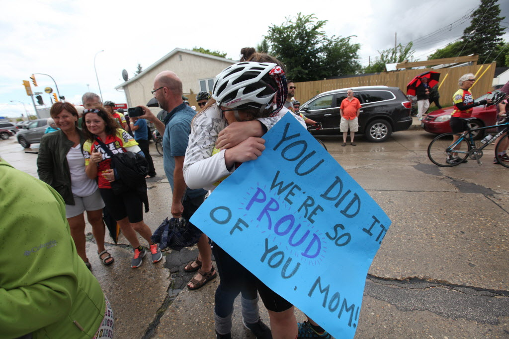 Risa Olekshy gets a grand welcoming from her daughter Tasha after cycling with 48 others from Niagara Falls 1,000 miles home to Winnipeg over a two-week period all to raise money for a new home, built by Habitat for Humanity.