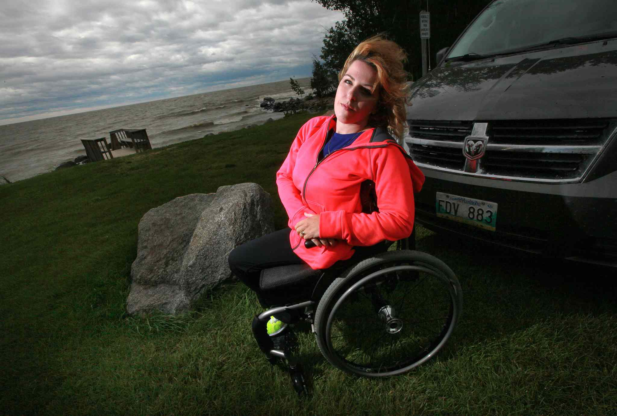 Janis Ollson poses near her cottage beside Lake Winnipeg. Victoria Beach will not allow the handicapped woman vehicle access to their beach for her kid's swimming lessons. (Phil Hossack / Winnipeg Free Press)