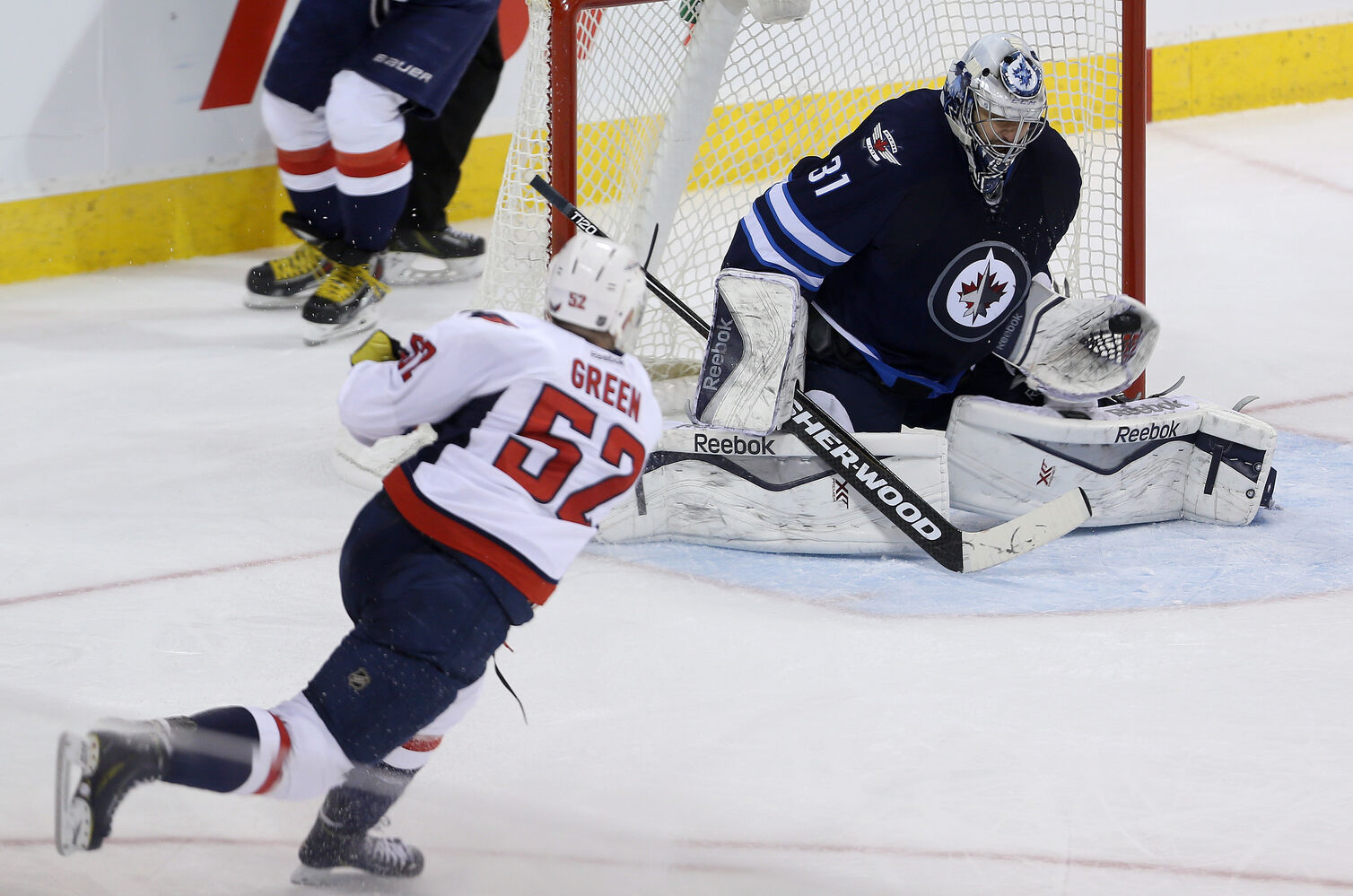 Ondrej Pavelec denies the Caps' Mike Green, as he did all the Caps who tried to penetrate the fortress that was his net Saturday night.  (Trevor Hagan / Winnipeg Free Press)