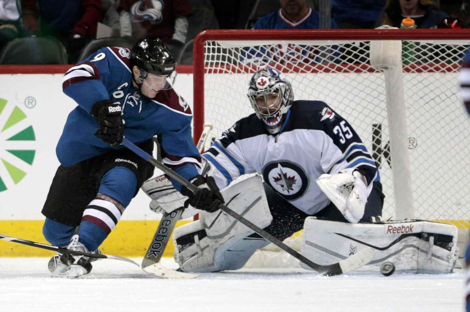Colorado Avalanche center Matt Duchene (left) reaches for the puck in front of Winnipeg Jets goalie Al Montoya during the second period.
