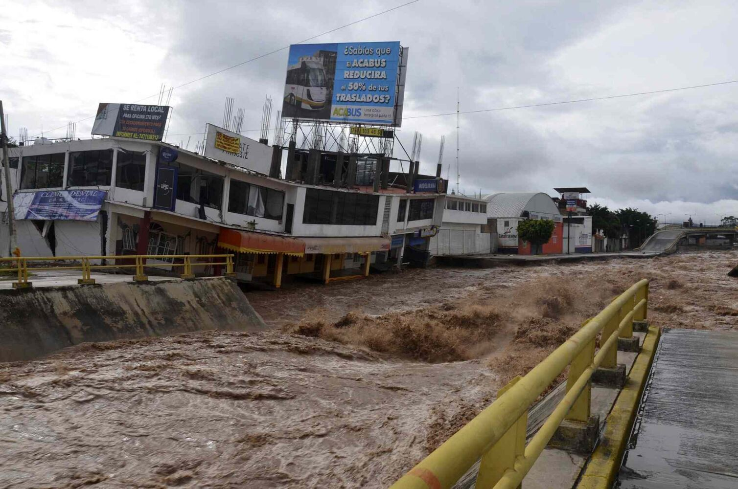 Floodwaters rage past an urban area after the Huacapa River overflowed due to heavy rains caused by Tropical Storm Manuel in Chilpancingo, Mexico, Monday, Sept. 16, 2013.  (Alejandrino Gonzalez / The Associated Press)