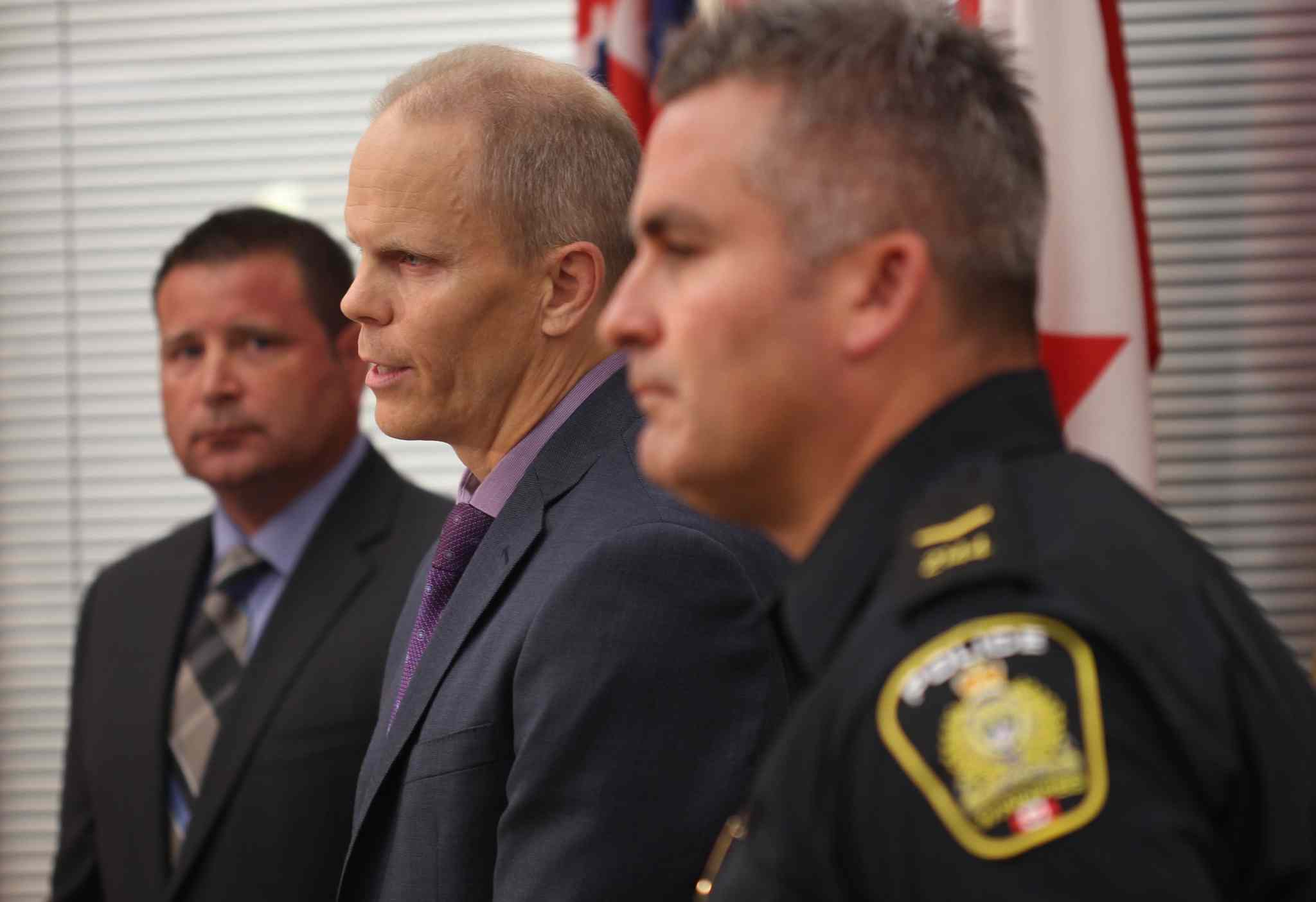L to R- Acting Inspector Gene Bowers Winnipeg Police Service Counter Exploitation Unit (CEU) with Cam MacKid of CEU and Constable Jason Michalyshen speak of charges from Project Create, an initiative to combat the sex trade in Winnipeg. (Joe Bryksa / Winnipeg Free Press)