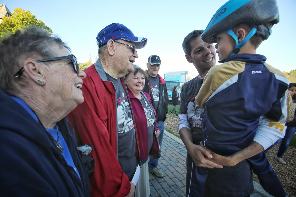 Mayor Brian Bowman introduces his son to Terry Fox's father Rolly just before the 35th annual Terry Fox run/walk/bike at Assiniboine Park Sunday morning.  (Mike Deal / Winnipeg Free Press)