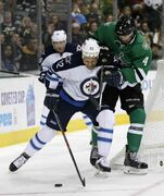 Winnipeg Jets center Olli Jokinen fights off Dallas Stars defenceman Brenden Dillon during the second period.