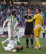 Real Madrid's Cristiano Ronaldo, second right, reacts as Cordoba's Fraga, below, lies on the pitch during their La Liga soccer match at the Arcangel stadium, in Cordoba, Spain on Saturday, Jan. 24, 2015. (AP Photo/Miguel Morenatti)