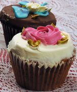 FILE - This Nov. 29, 2006 file photo shows cupcakes from Cupcake Cafe, in New York. Many people love the idea of cutting into a giant wedding cake and getting the photos that come with it. But if you're not a cake fan, other dessert options like cupcakes, cookies, doughnuts, or a dessert bar may cost a lot less. (AP Photo/Donald King, File)