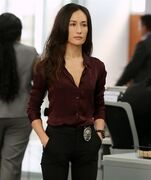 In this image released by CBS, Maggie Q appears in a scene from