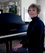 Phyllis Thomson, 79, sits at her piano where she teaches singing lessons. She said teaching is one of the most rewarding parts of her life.