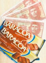 Cuba's best chocolate is shown with three peso bills that feature the image of Che Guevara.