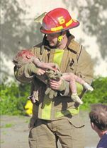 Charles H. Porter IV / The Associated Press filesOklahoma City fire captain Chris Fields carries the body of Baylee Almon in the wake of the bombing.