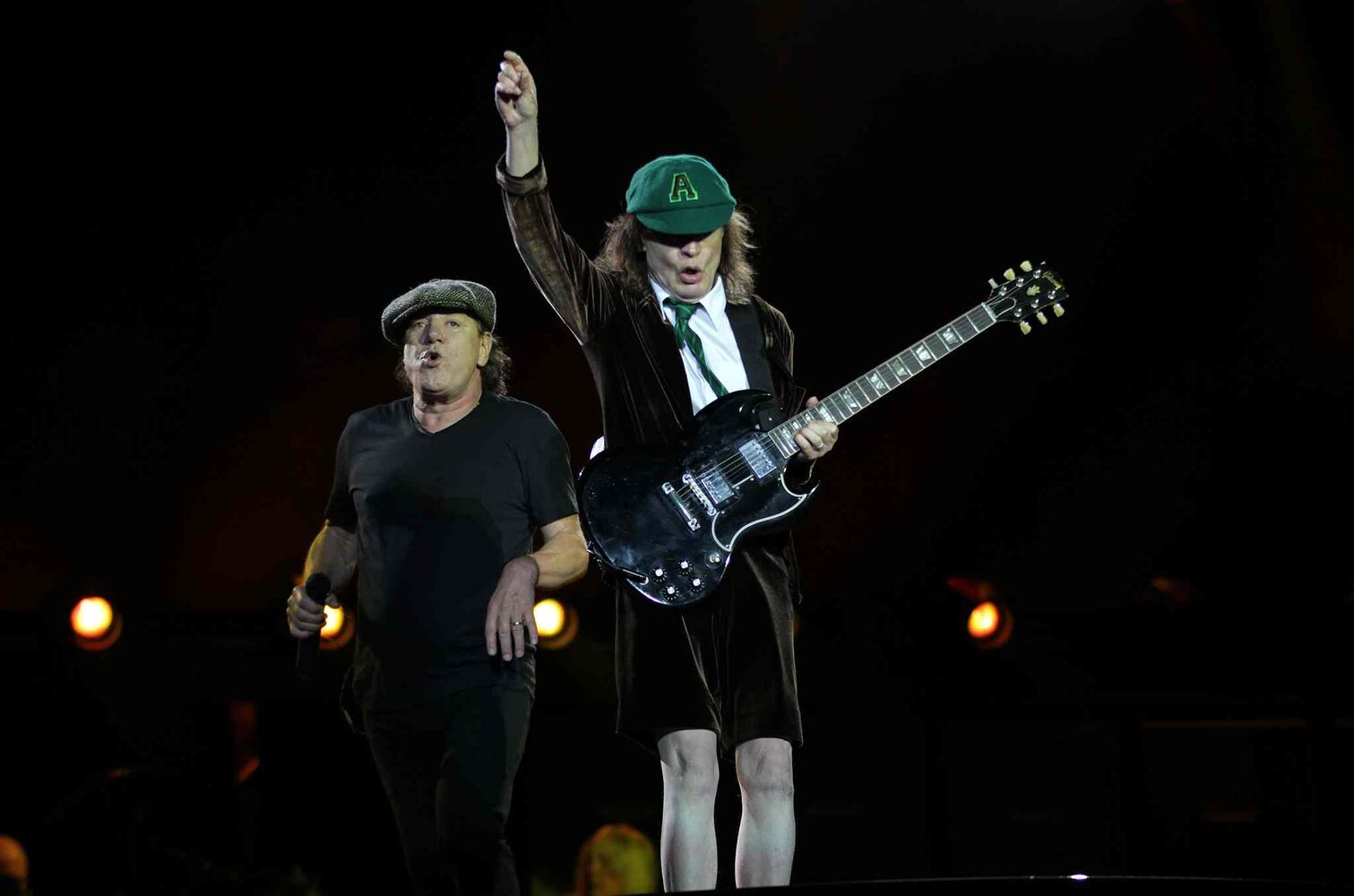 AC/DC's Brian Johnson and Angus Young (right) at the Investor's Group Field in Winnipeg Thursday.  September 17, 2015 - (Phil Hossack / Winnipeg Free Press)