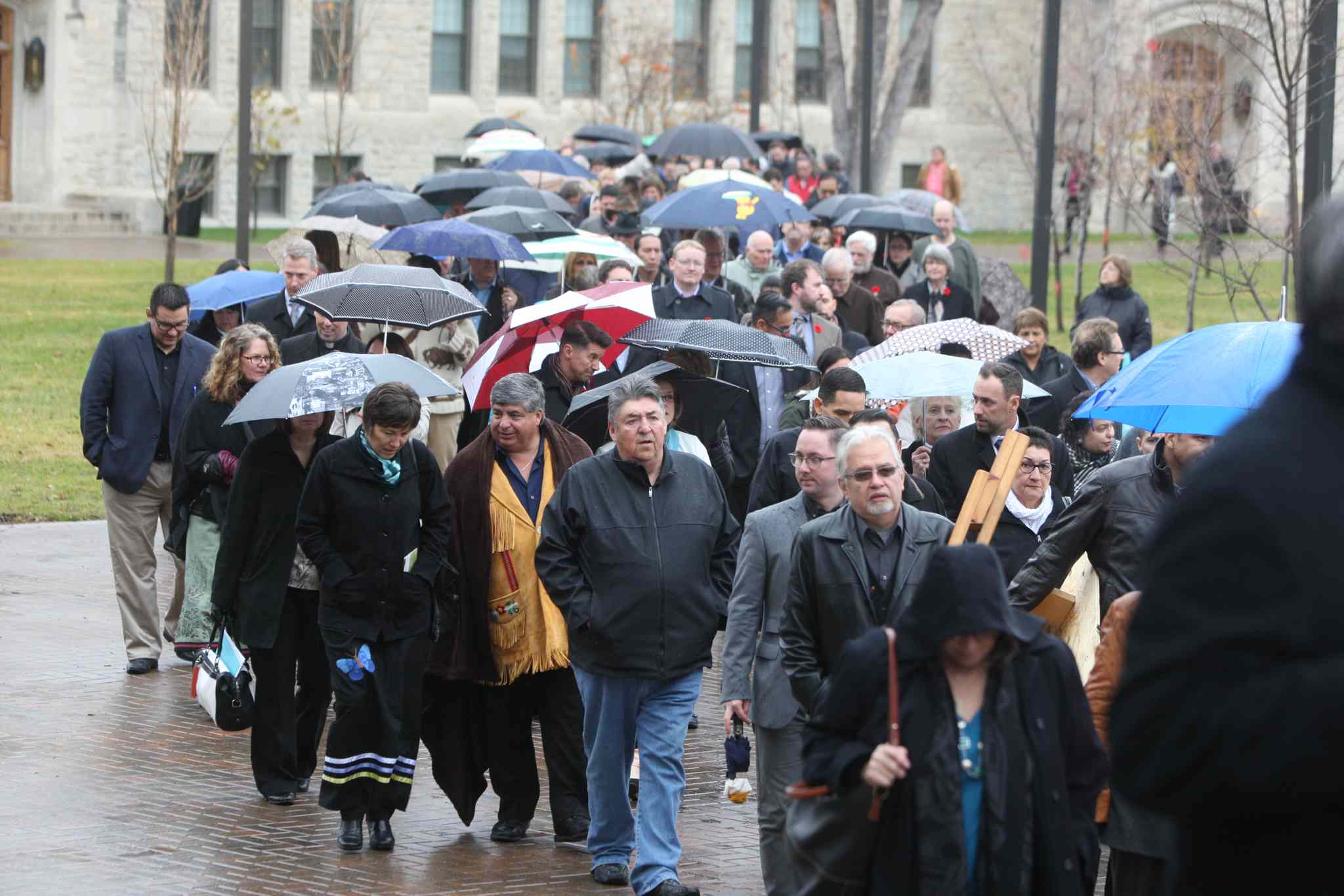 A large group marched to the University Centre for the grand opening of the National Research Centre.