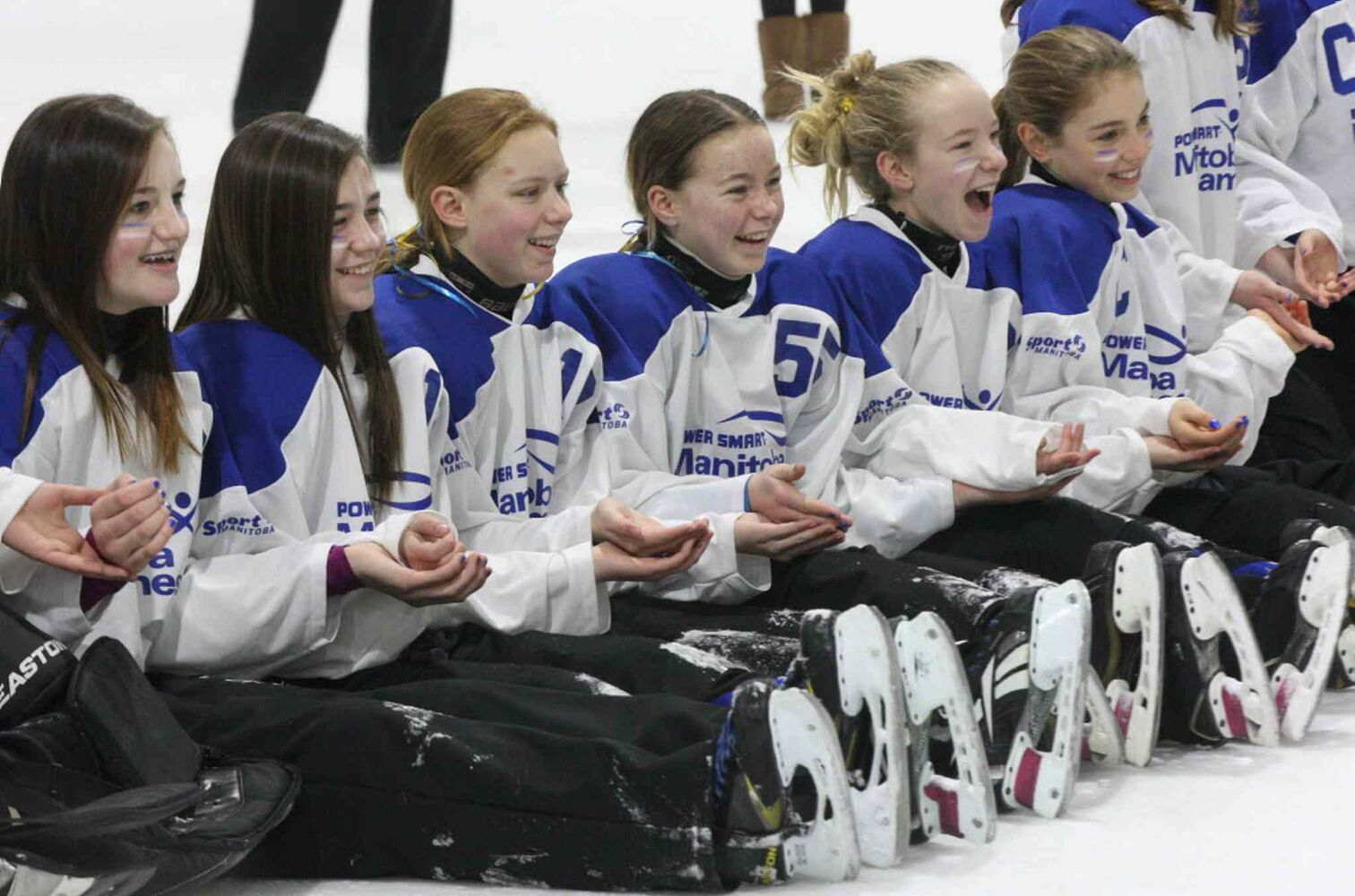 Silver metalist ringette team from Interlake all smiles as they wait for their medals. (JOE BRYKSA / WINNIPEG FREE PRESS)