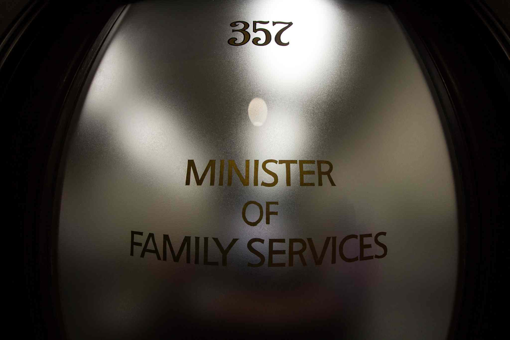 The office door for the minister of family services in the Manitoba legislature. One senior provincial official says it is the worst job in government.