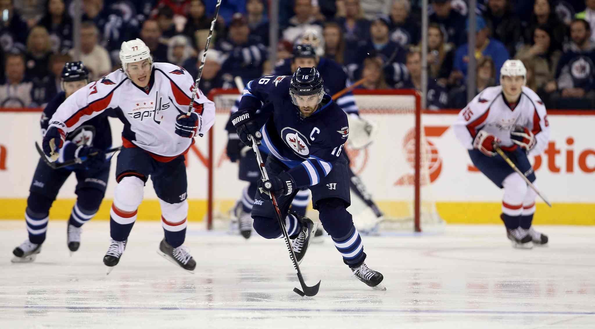 Winnipeg Jets' Andrew Ladd (16) carries the puck up ice against the Washington Capitals. Dec. 5.