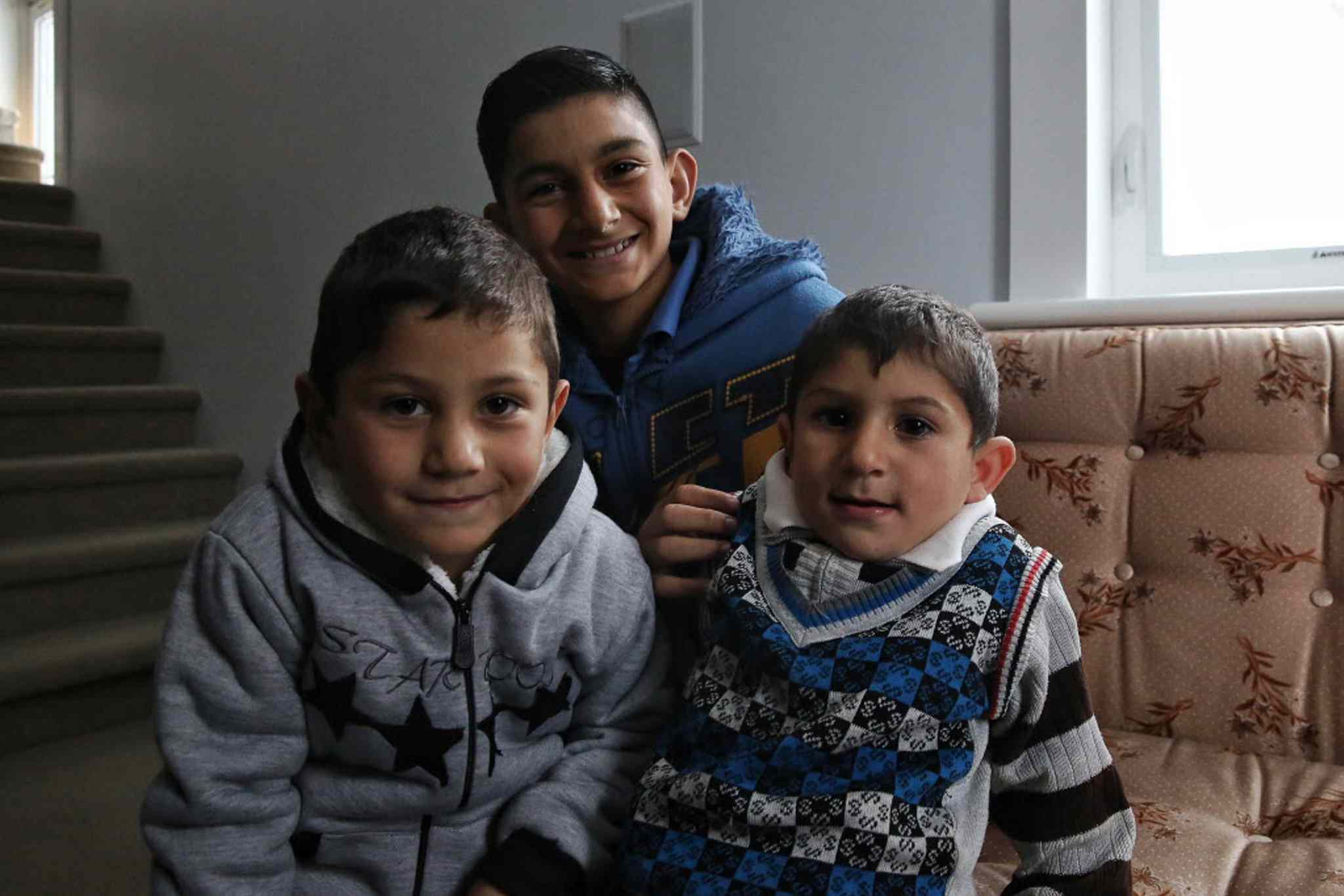 Ahmad Daas and his wife Ahlam Dib were welcomed to Altona along with their seven children, including (from left)  Majed, 4, Mohamad, 12, and Joad, 3.