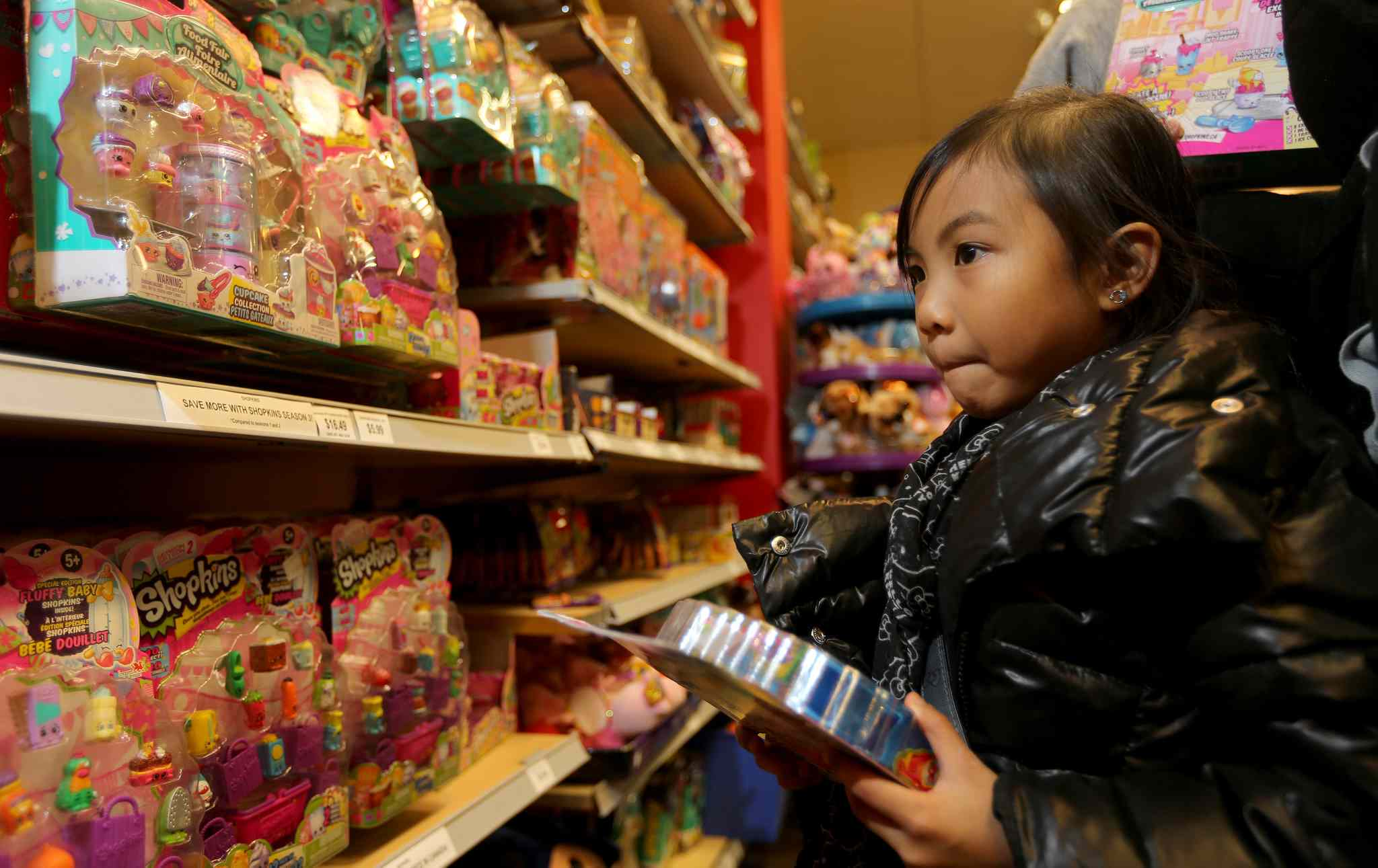 Brooklyn Manzano, 5, looks at Shopkins in the Showcase Store at Polo Park.