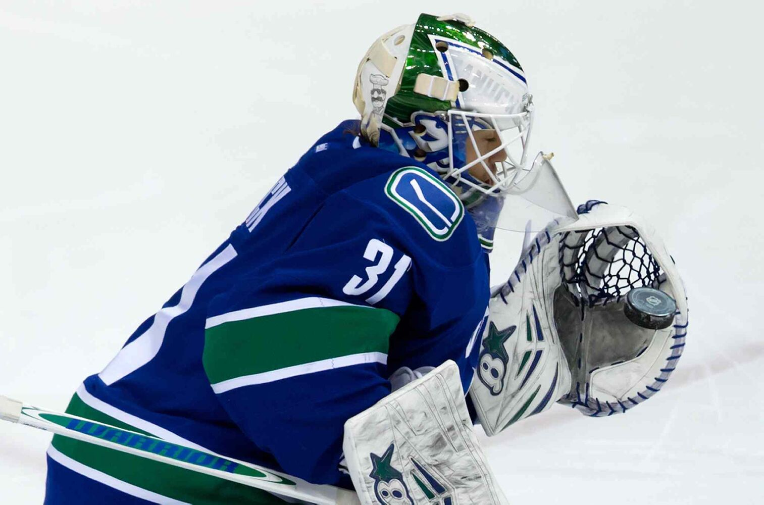 Vancouver Canucks goalie Eddie Lack makes a glove save against the Winnipeg Jets during the second period.