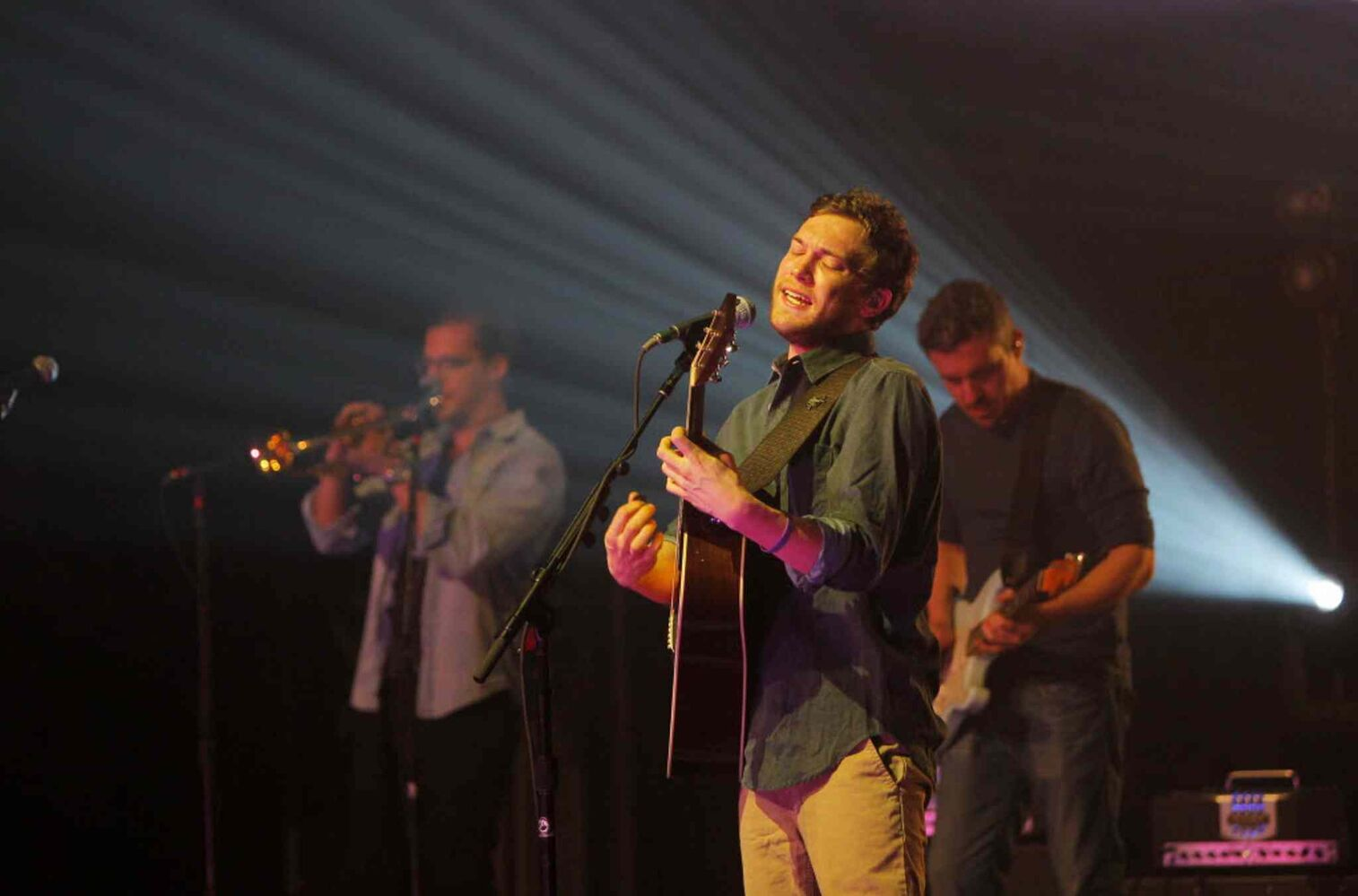 Phillip Phillips strumming on his six-string at the Burton Cummings Theatre.