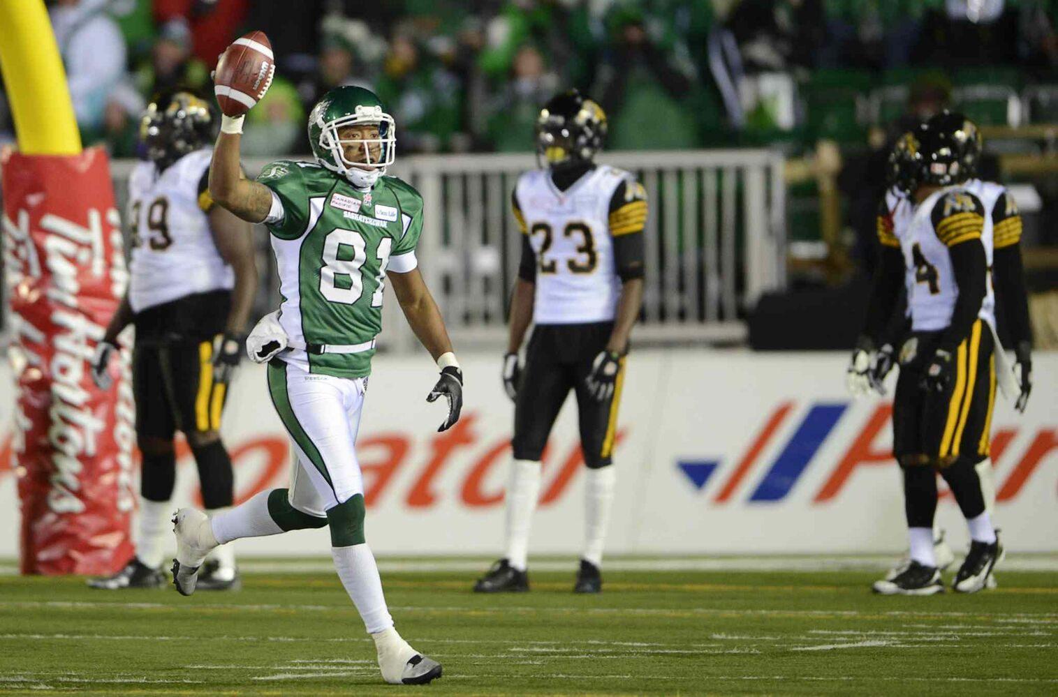 Saskatchewan Roughriders slotback Geroy Simon celebrates his second touchdown against the Hamilton Tiger-Cats during the second quarter. (Ryan Remiorz / The Canadian Press)