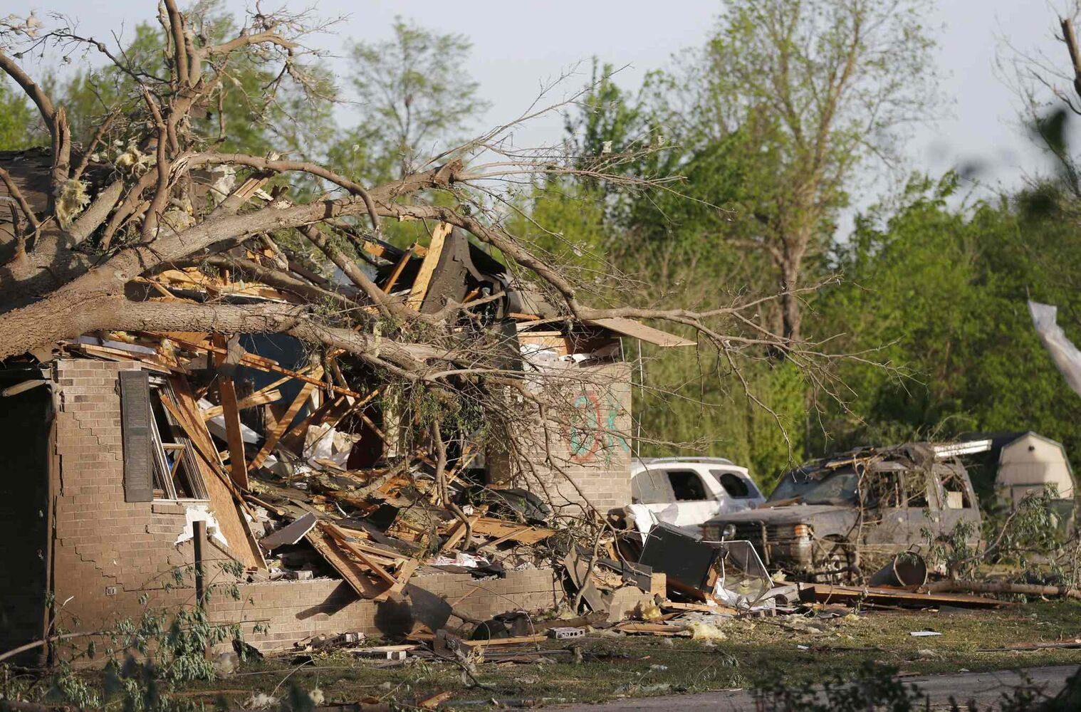 A tornado-damaged home awaits clean up and repairs after a Sunday tornado in Baxter Springs, Kan., Monday, April 28, 2014.  (Orlin Wagner / The Associated Press)