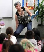 'And then her eyes got HUGE!': Meg Tilly reads to King Edward School students Monday morning.