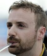 James Hinchcliffe, of Canada, takes a drink as he looks at times during practice for the IndyCar Firestone Grand Prix of St. Petersburg auto race Friday, March 27, 2015, in St. Petersburg, Fla. The race takes place on Sunday. (AP Photo/Chris O'Meara)