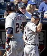 Detroit Tigers' Ian Kinsler (3) celebrates with Miguel Cabrera (24) after Kinsler hit a solo home run during the third inning of a baseball game against the Kansas City Royals Sunday, Sept. 21, 2014, in Kansas City, Mo. (AP Photo/Charlie Riedel)