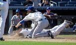 Rangers lose again in 9th; Yankees win 2-1 on passed ball
