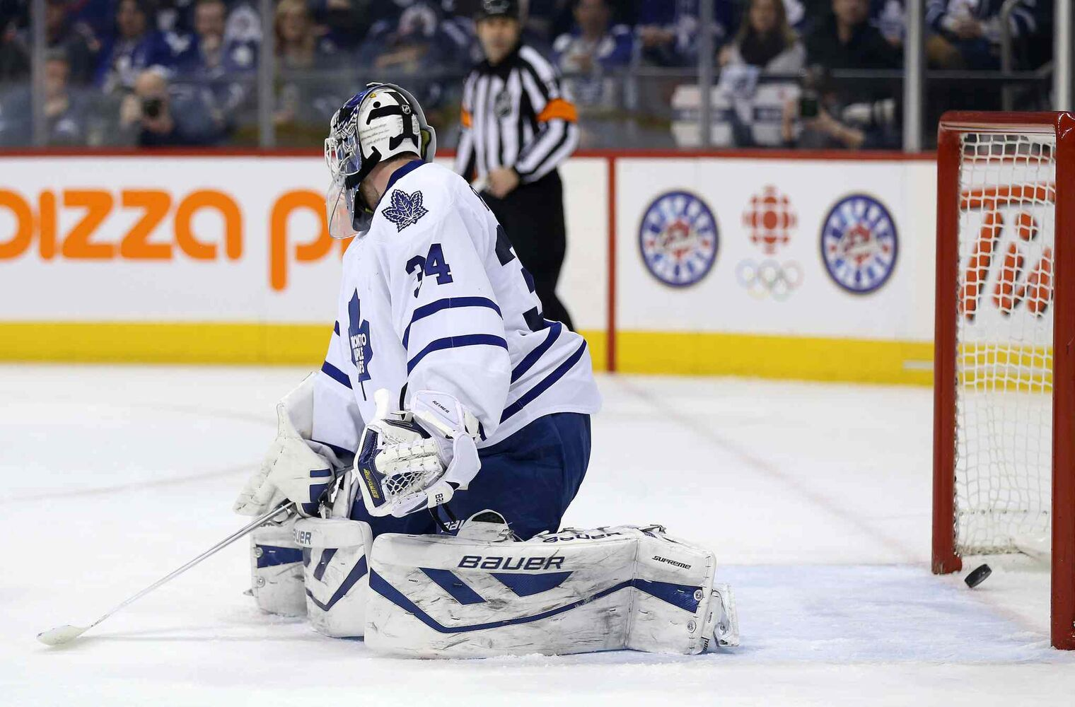 A shot by Winnipeg Jets' Zach Bogosian (44) gets past Toronto Maple Leafs' goaltender James Reimer (34) during  the second period of Saturday's game. (Trevor Hagan / Winnipeg Free Press)