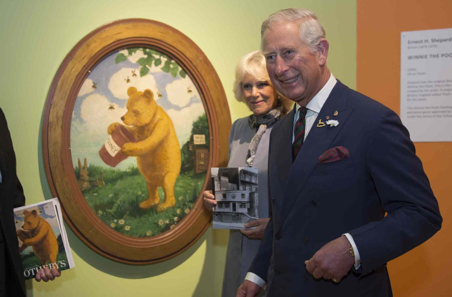 Prince Charles and his wife Camilla at the Pooh Gallery, which houses a collection of Winnie the Pooh artifacts and memorabilia, including the first painting of Winnie the Pooh by E.H. Shepherd,  (Paul Chiasson / The Canadian Press)