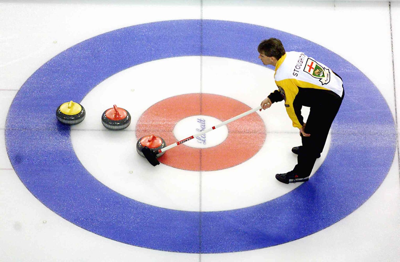 Jeff Stoughton uses his broom to indicate which rock he wants his team to remove during 16th draw of competition against PEI at The Brier in Edmonton in 1999. (Chuck Stoody / The Canadian Press Files)