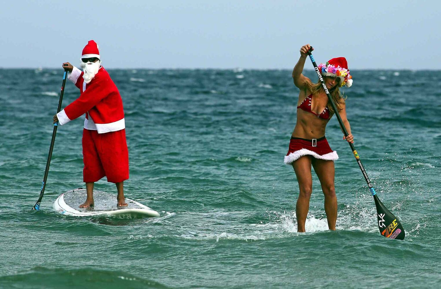 Santa and Mrs. Claus ride the waves off of Fort Lauderdale, Fla. (Mike Stocker / Tribune Media MCT)