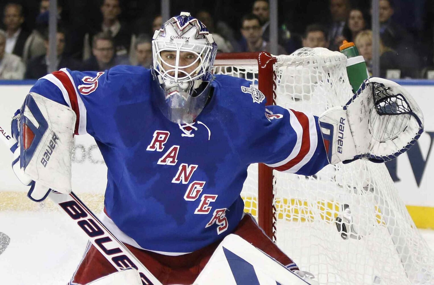 New York Rangers' goalie Henrik Lundqvist (30) looks for the rebound after a shot by the Los Angeles Kings in the first period during Game 4 of the NHL hockey Stanley Cup Final.