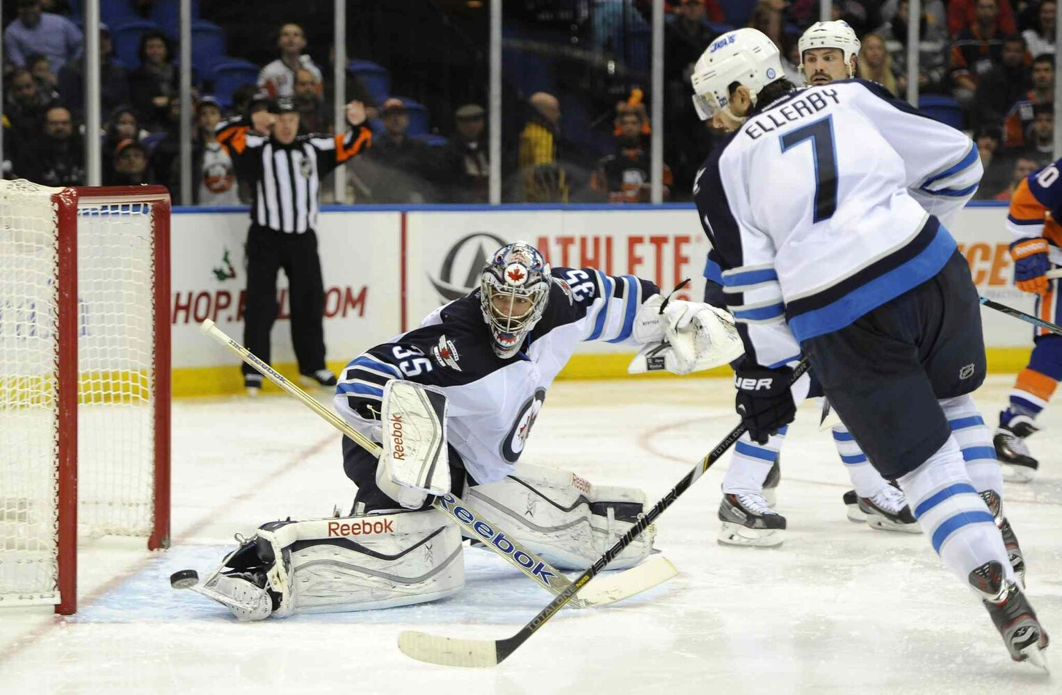 Winnipeg Jets goalie Al Montoya (left) kicks the puck away from the goal as defenceman Keaton Ellerby watches during  the second period. (Kath Kmonicek / The Associated Press)