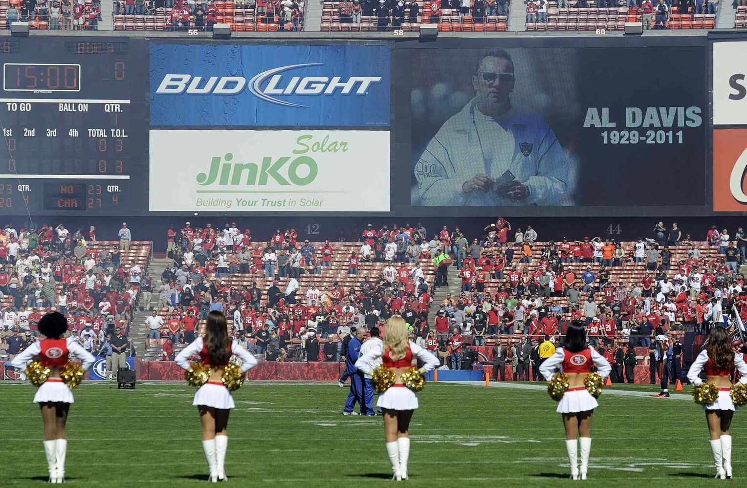 Fans observe a moment of silence for Oakland Raiders owner Al Davis, who passed away October 8, 2011, at a game the following day between the San Francisco 49ers and Tampa Bay Buccaneers.
