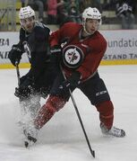 The Winnipeg Jets took to the ice at the MTS IcePlex Sunday morning for another day of training camp. Adam Lowry (56) and Julien Brouillette (49) during training camp.