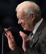 Former President Jimmy Carter speaks during the memorial service for the Rev. Theodore Hesburgh, Wednesday, March 4, 2015, in the Purcell Pavilion at the University of Notre Dame in South Bend, Ind. Hesburgh served as the school's president for 35 years while also promoting human rights. Hesburgh died Thursday, Feb. 26. He was at 97. (AP Photo/South Bend Tribune, Robert Franklin)