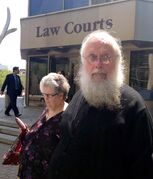 Seraphim (Kenneth) Storheim, now retired from the Orthodox Church in America, leaves the courthouse in Winnipeg in a file photo.
