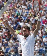 Marin Cilic, of Croatia, reacts after defeating David Ferrer, of Spain, during the third round of the 2014 U.S. Open tennis tournament, Sunday, Aug. 31, 2014, in New York. (AP Photo/Seth Wenig)
