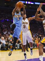 Denver Nuggets guard Ty Lawson (3) gets by Los Angeles Lakers guard Ronnie Price (9) as he goes to the basket in the first half of an NBA basketball game, Sunday, Nov. 23, 2014, in Los Angeles.(AP Photo/Gus Ruelas)