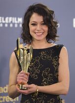Actor Tatiana Maslany with her award for best performance in a continuing dramatic role at the Canadian Screen Awards in Toronto on Sunday March 9, 2014. THE CANADIAN PRESS/Fred Thornhill