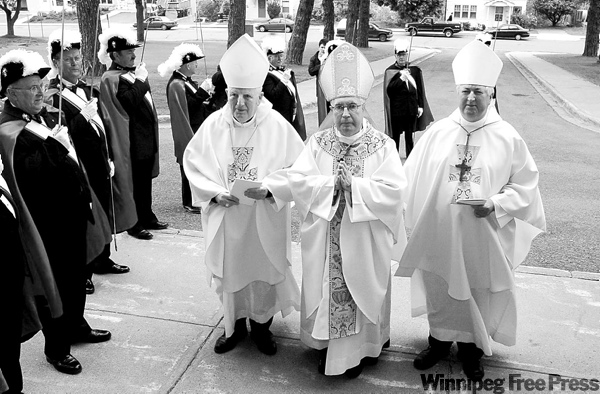 Peter Parsons / the canadian press archives Bishop Raymond Lahey (centre) is seen in 2003 file photo. Lahey now faces child-pornography charges.