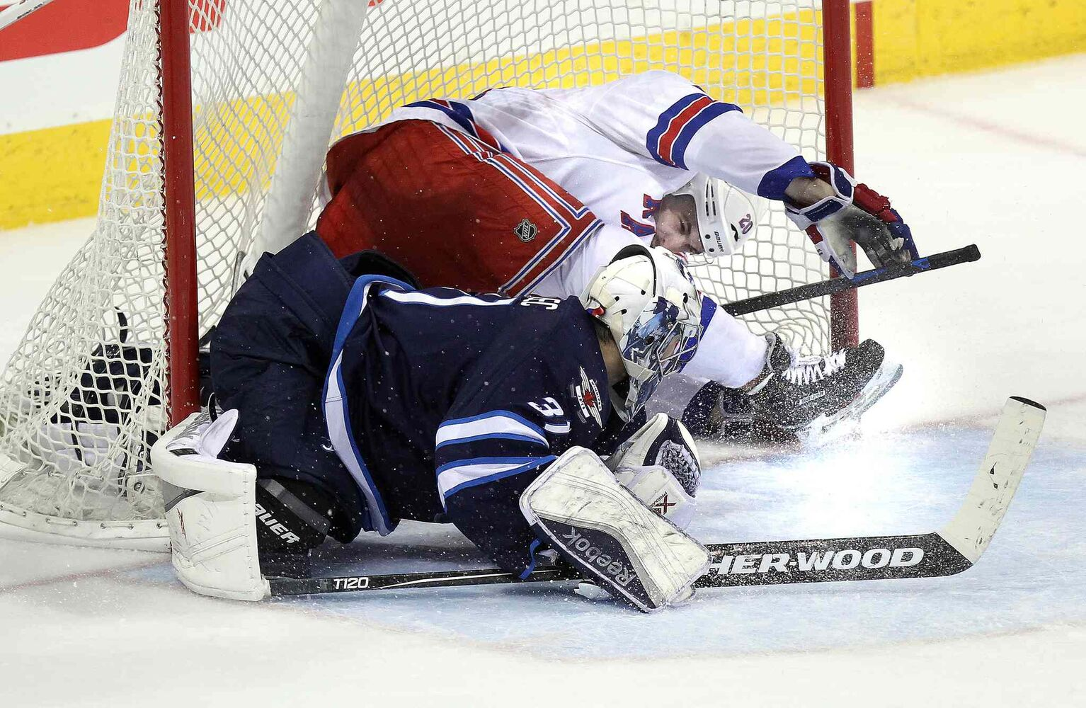 New York Rangers Chris Kreider and the puck wound up in the net behind Ondrej Pavelec late in the third period, resulting in Kreider's game-winning goal. (Phil Hossack / Winnipeg Free Press)