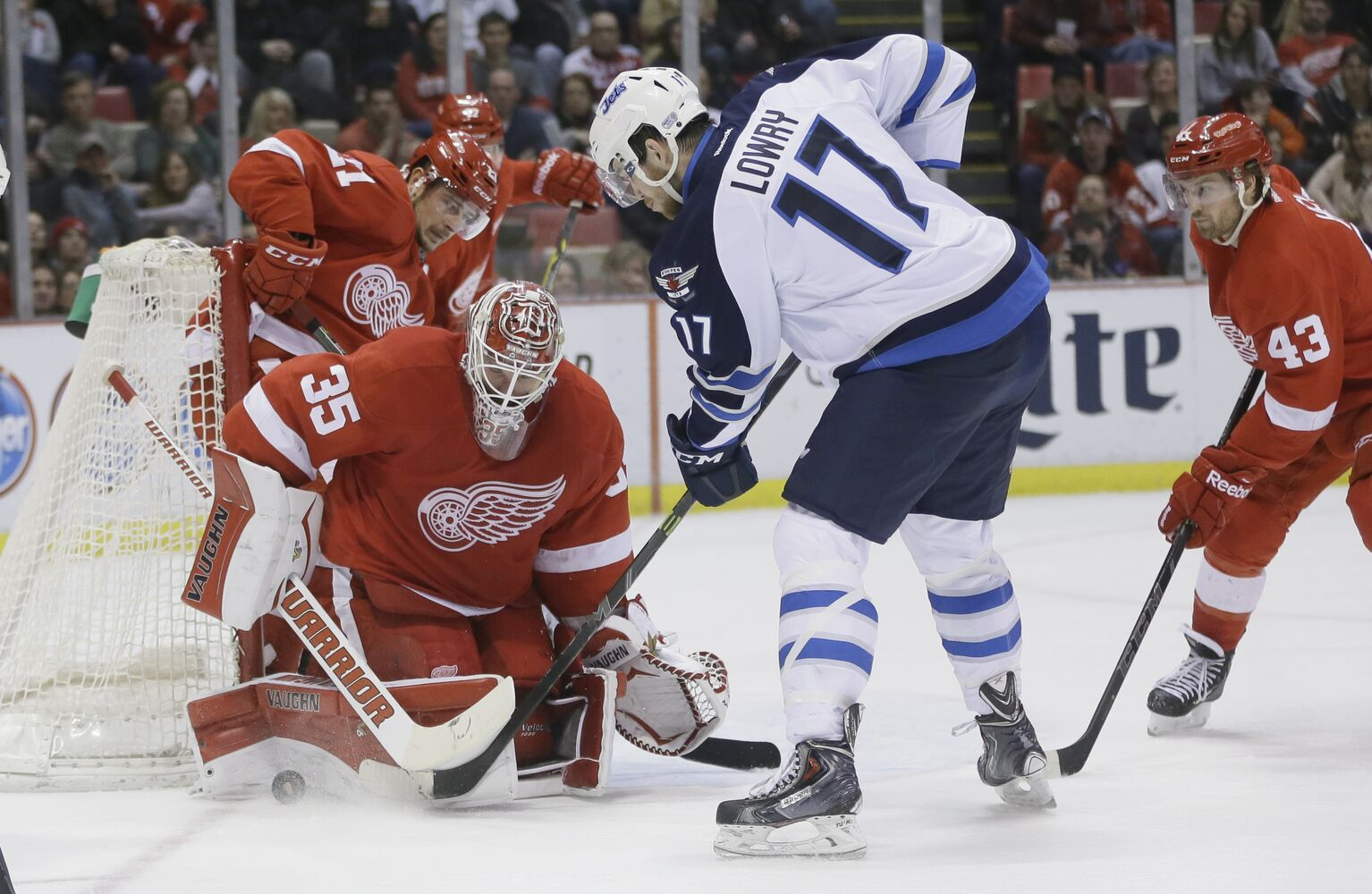 Adam Lowry bears down on Red Wings goalie Jimmy Howard. (Carlos Osorio / The Associated Press)