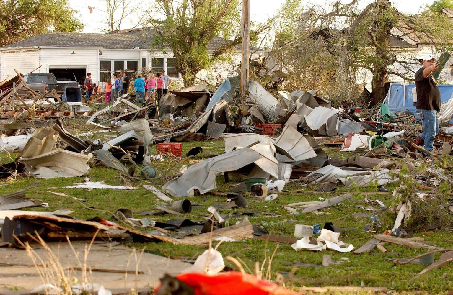 Quapaw, Okla., residents survey the damage in a residential neighbourhood struck by a tornado on Sunday evening. (GARY CROW / TULSA WORLD / THE ASSOCIATED PRESS)